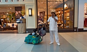 A domestic worker in The Avenues shopping mall, Kuwait City. The country has the highest ratio of domestic workers to citizens in the Middle East.