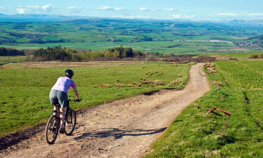 Mountain biker descending on Caton Moor above Hornby in the Lune valley.