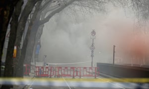 Smoke fills the streets around the scene of the fire