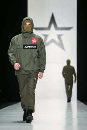A model showcases creations by Army of Russia fashion brand at the 2015 Mercedes-Benz Fashion Week Russia.