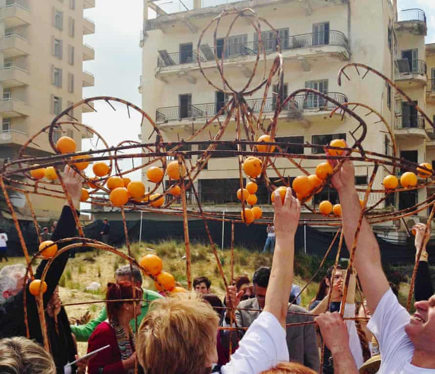 Turkish and Greek Cypriot activists decorate an old Famagusta orange festival float.