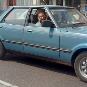 At the wheel of a blue Granada