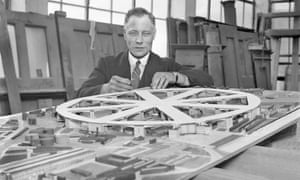 Architect Chas Glover with a model for an airport to be built over the roofs of Kings Cross and St Pancras railway stations.