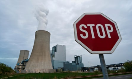 Steam rises from cooling towers at the Neurath coal-fired power plant