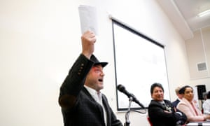 George Galloway brandishing what he claimed was the nikah, an Islamic marriage certificate, belonging to his Labour rival, Naz Shah.