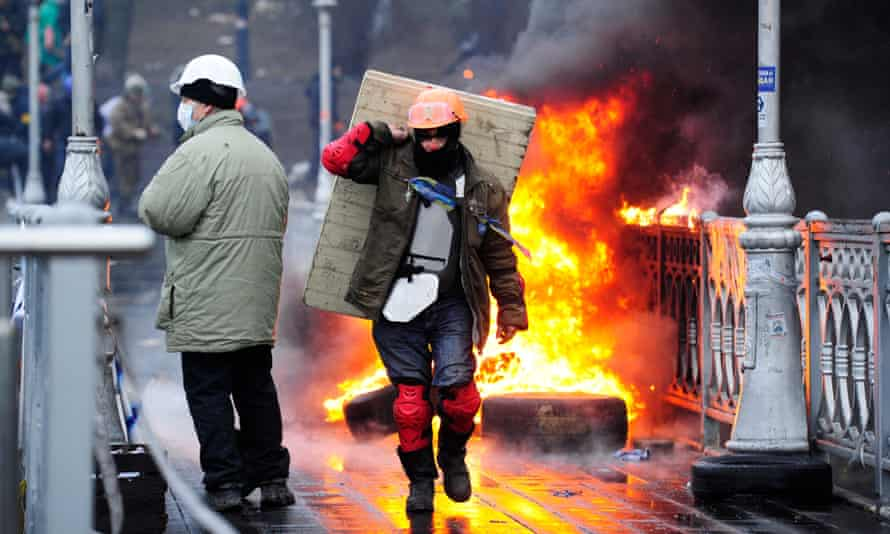 Anti-government protesters clash with police on the Maidan in Kiev before the fall of Yanukovych.