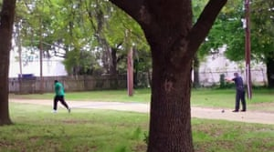 Police officer Michael Slager is seen allegedly shooting 50-year-old Walter Scott in the back as he runs away, in this still image taken from video in North Charleston, South Carolina. Slager was charged with murder after the video showed him shooting at Scott eight times. The video also appears to show Slager picking an object off the ground and dropping it next to Scott's body