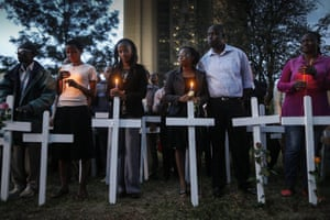 Kenyans attend a candlelit vigil for the 148 people killed in the attack on Garissa University. Hundreds gathered in solidarity to mourn the loss of their countrymen, while five suspects were arraigned in a Nairobi court on suspicion of supplying the attackers with the guns used in the attack