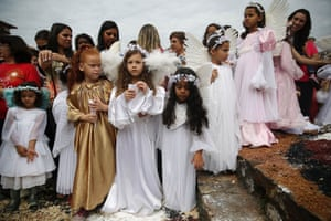 Girls are dressed as angels during the annual Easter procession at the end of Semana Santa in Ouro Preto, Brazil. Ouro Preto was a colonial mining town founded in the late 17th century and the Semana Santa tradition there can be traced back to the Portuguese colonial period in the 18th century