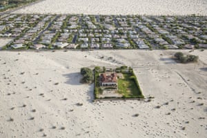 The encroaching desert surrounds homes in the golf resort city of Rancho Mirage, southern California. A fourth year of drought has prompted state governor Jerry Brown to order a 25% cut in domestic water consumption
