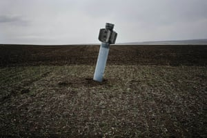 An unexploded rocket in a field near the village of Dmitrivka, Ukraine. As a tenuous ceasefire brings respite after the year-long conflict between pro-Russian rebels and Ukrainian troops, the danger of landmines now threatens lives, particularly on once-rich agricultural lands
