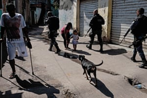 A police special unit patrols a shantytown at Alemao in Rio de Janeiro, Brazil. Fresh violence in the city's slums has led to growing doubts over the effectiveness of Brazil's seven-year-old strategy of pacifying districts in thrall to gangs and drug traffickers