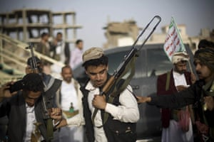 Shia rebels, known as Houthis, perform a traditional dance during a protest against the Saudi-led airstrikes in Sanaa, Yemen. The Red Cross warned of a 'catastrophic' situation in the country as the war engulfed the city of Aden
