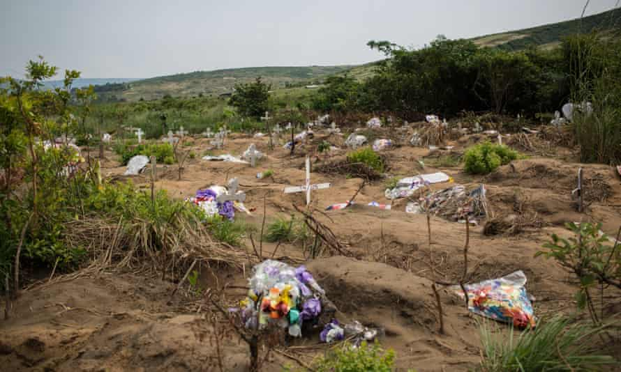 Flowers are seen at the mass common grave at Maluku, near Kinshasa. Authorities claim stillborn babies and unclaimed corpses are buried at the site.