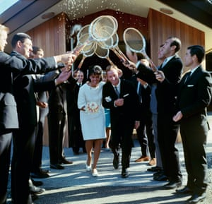 1966 Rod Laver and Mary Benson emerge from St. Luke's Presbyterian Church and walk under an arch of tennis rackets held by a guard of honour made up of the Aussie's fellow players