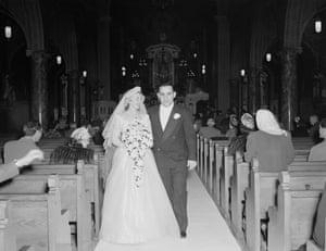 1949 Yogi Berra and Carmen Short walk down the aisle at St. Ambrose's Catholic Church in St. Louis, Missouri