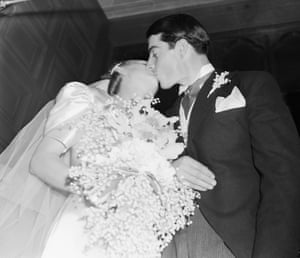 1939 Joe DiMaggio, Yankee outfielder, kisses his bride, the former Dorothy Arnold, film actress, after their marriage in the Church of Saints Peter and Paul in San Francisco, California. A crowd of more than 10,000 people gathered outside the church to see the baseball hero and his bride
