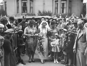 1930 British Channel swimmer Mercedes Gleitze arrives at St Paul's Church, Dover before her wedding to Patrick Carey. Her bridesmaids were American swimmers the Zitenfeld twins, Bernice and Phyllis