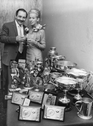 1970 Speedway driver Split Waterman and his bride Avril, posing with his many championship trophies, on display at their wedding reception, at St Ermin's Hotel, London