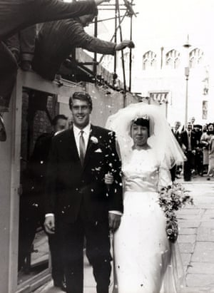 1964 West Ham United and England striker Geoff Hurst walking with his bride Judith after their wedding at Chelmsford Cathedral