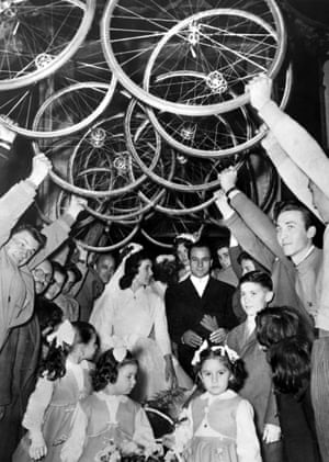 1955 Italian cycling legend Antonio Maspes and his newlywed bride Liliana Vaschetto exit the church after being married in Milan