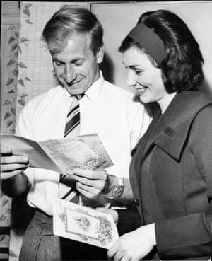 1961 Manchester United and England's Bobby Charlton and his wife to be Norma Bell check out cards from well-wishers on the morning of their wedding