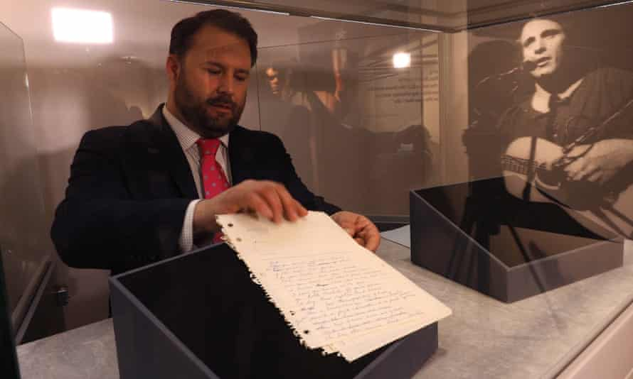 A curator handles the original handwritten lyrics to the song American Pie by Don McLean, which are to be auctioned at Christie's in New York.