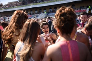Racegoers laugh on the final day of the Grand National Festival horse race meeting at Aintree Racecourse in Liverpool.