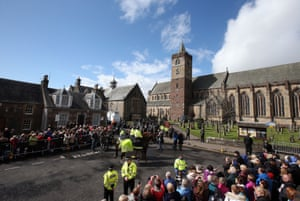 People gather outside the cathedral