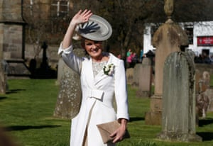 Judy Murray gives a wave to the crowds as she arrives for her son's nuptials