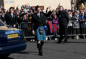 The groom gives a wave to his fans before heading into the cathedral