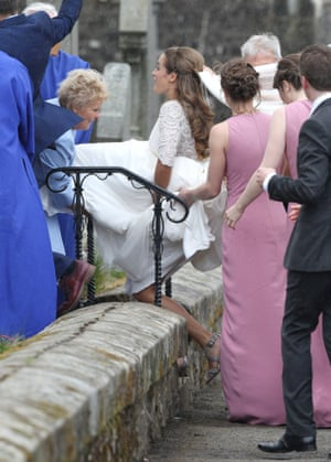 Kim Sears hurries into the church to avoid the rain