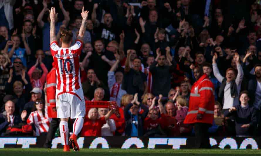 Marko Arnautovic of Stoke City celebrates with fans after the match.