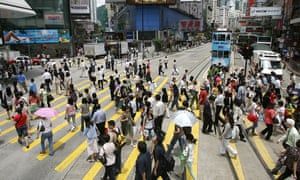 Shoppers cross the street in the Causeway Bay district of Hong Kong.