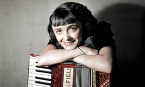 Edith Piaf, with an accordion, in 1936.