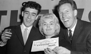 Bruce Forsyth, right, presents Viv Nicholson and her husband, Keith, with a cheque from Littlewoods in 1961.