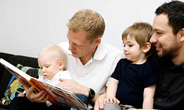 Fathers reading a book to their children