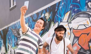 SBS television host Samuel Johnson snaps a selfie with a beard-loving hipster.