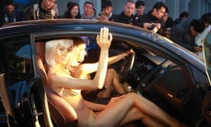 Models inside cars promote Fast & Furious 7 in Bejing.