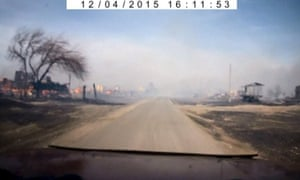 Still image from dashcam footage shows buildings destroyed by fire in village in Khakassia.