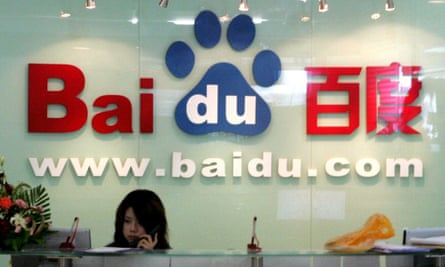 A receptionist works behind the logo for Baidu.com, the Chinese search engine whose customers were hijacked by the first firing of the Great Cannon.