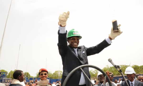 Chad's president, Idriss Deby, holds a glass filled with oil in Badila, southern Chad, during the opening of an oil valve operated by Canadian oil explorer Caracal Energy.