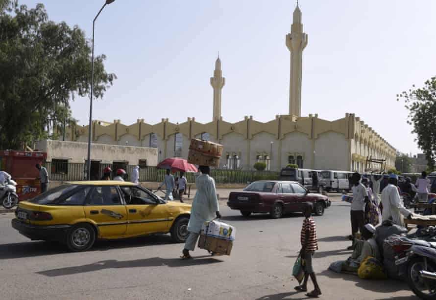 People walk near the Central Mosque in N'Djamena.