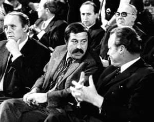 Gunter Grass  chatting with then German Chancellor Willy Brandt (R) and his colleague Heinrich Boell (L) looking on during the 1st congress of the German Writers' Association in Stuttgart, 1970