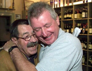 Grass is hugged by his neighbour Kurt Thater, owner of a wine store close to Grass's Lubeck office after he was announced as the winner of  the Nobel Prize for Literature on September 30 1999
