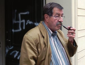 Grass smokes a pipe in front of his house which was defaced with swastikas the night before, 1997