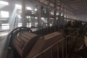 The massive centrifuges and grinding of a stage 1 rare earth refinery.  According to the Chinese Society of Rare Earths, 9,600 to 12,000 cubic meters (340,000 to 420,000 cubic feet) of waste gas   containing dust concentrate, hydrofluoric acid, sulfur dioxide, and sulfuric acid   are released with every ton of rare metals that are mined. Approximately 75 cubic meters (2,600 cubic feet) of acidic wastewater, plus about a ton of radioactive waste residue are also produced.
