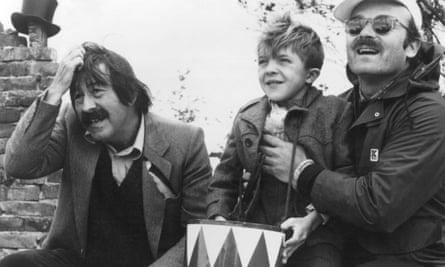 Günter Grass, left, with actor David Bennent as Oskar Matzerath and director Volker Schlöndorff on the set of the film version of The Tin Drum, based on Grass's novel.