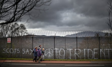 Anti-nuclear activists block one of the entrances to Faslane naval base on the Clyde in Scotland.