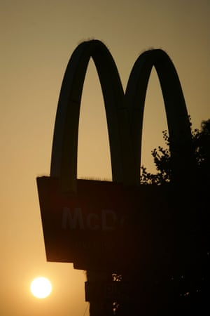 FILE - LOS ANGELES, CA - JULY 24:  The sun rises behind the golden arches of a McDonalds restaurant on July 24, 2008 on Figueroa Street in the South Los Angeles area of Los Angeles, California. The Los Angeles City Council committee has unanimously approved year-long moratorium on new fast-food restaurants in a 32-square-mile area, mostly in South Los Angeles, pending approval by the full council and the signature of Mayor Antonio Villaraigosa to make it the law. South LA has the highest concentration of fast-food restaurants of the city, about 400, and only a few grocery stores. L.A. Councilwoman Jan Perry proposed the measure to try to reduce health problems associated with a diet high in fast-food, like obesity and diabetes, which plague many of the half-million people living there.  (Photo by David McNew/Getty Images)